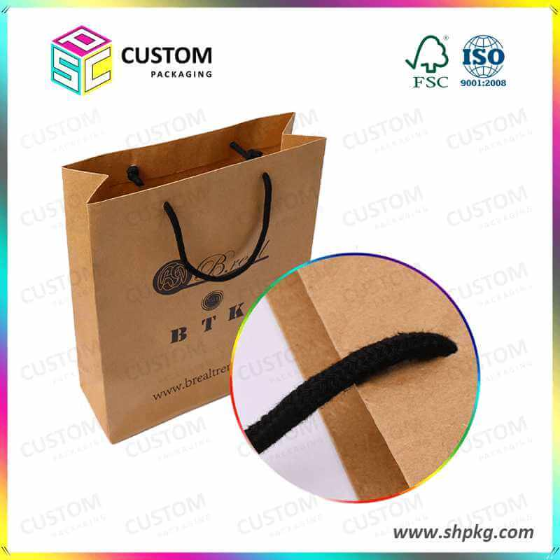 brown paper bag with black ribbon